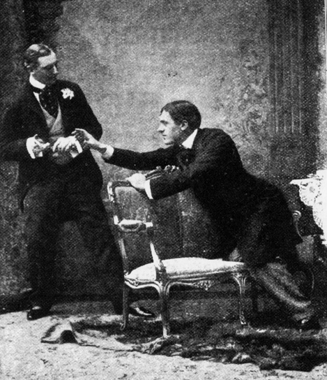 """The Importance of Being Earnest - Cigarettecase"" - Photograph taken at St. James's Theatre, London 1895. Licensed under Public Domain via Wikimedia Commons -"